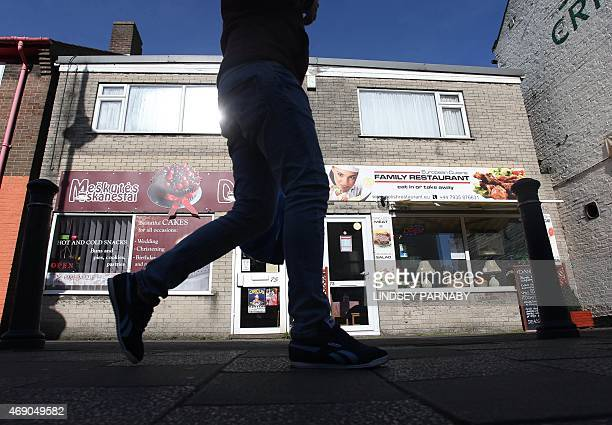 A man walks past an Eastern European restaurant in the market town of Boston in Lincolnshire on March 5 2015 For centuries the town of Boston in...