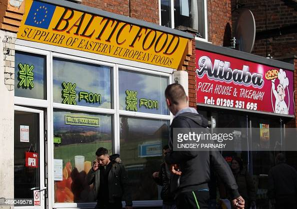 A man walks past an Eastern European shop in the market town of Boston in Lincolnshire on March 5 2015 For centuries the town of Boston in eastern...