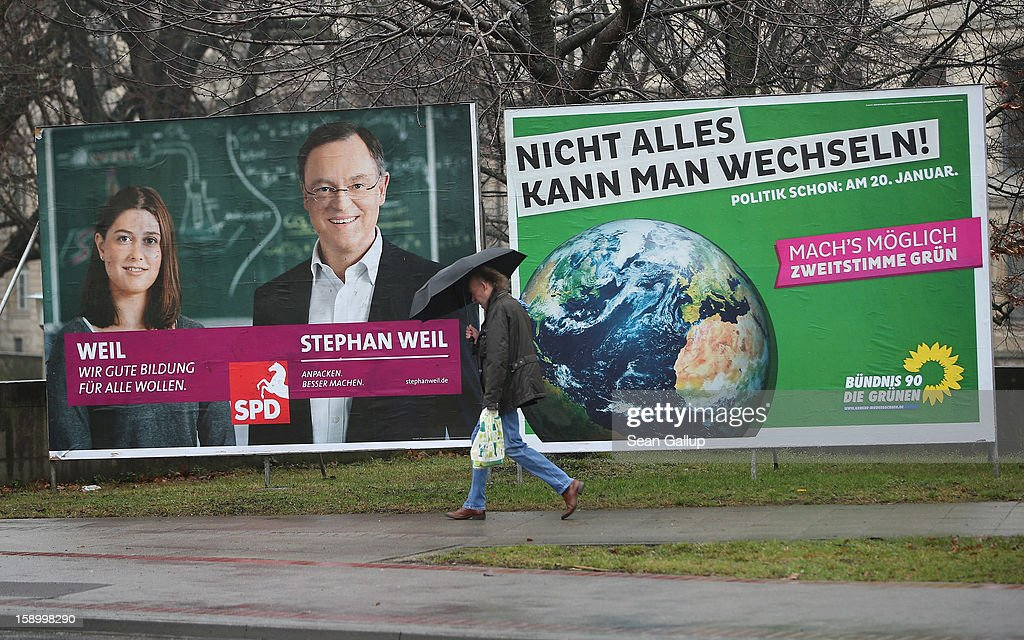 A man walks past an election campaign billboard featuring Hanover Mayor and German Social Democrats (SPD) candidate Stephan Weil (L) and one for the German Greens Party (Buendnis 90/Die Gruenen) on January 5, 2013 in Hanover, Germany. Lower Saxony is holding state elections on January 20 and many analysts see the election as a bellwether for national elections scheduled to take place later this year.