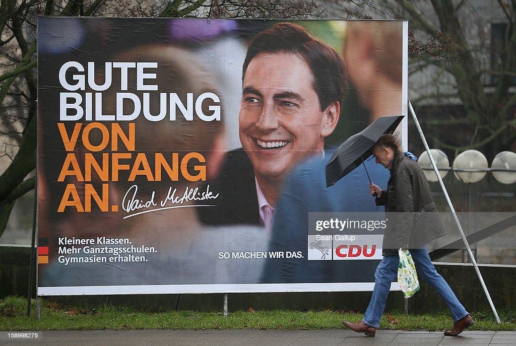 A man walks past an election campaign billboard featuring Lower Saxony Governor and incumbent candidate of the German Christian Democrats (CDU) David McAllister on January 5, 2013 in Hanover, Germany. Lower Saxony is holding state elections on January 20 and many analysts see the election as a bellwether for national elections scheduled to take place later this year.