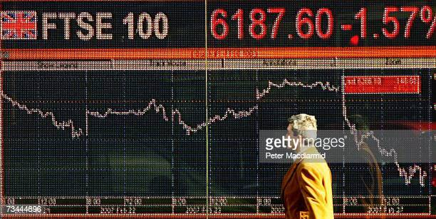 A man walks past an electronic sign displaying stock price information on February 28 2007 in London World stock prices have tumbled after...