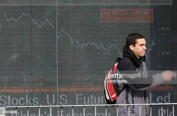 A man walks past an electronic sign showing the FTSE 100 share index on October 24 2008 on London England The FTSE fell by more than 300 points today...