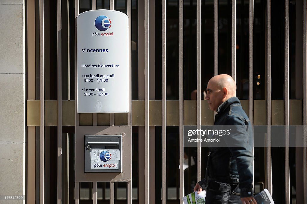 A man walks past an entrance of the Pole Emploi employment agency on April 24, 2013 in Vincennes, France. French unemployment keeps rising and the number of unemployed people could reach a new historical record in May 2013.