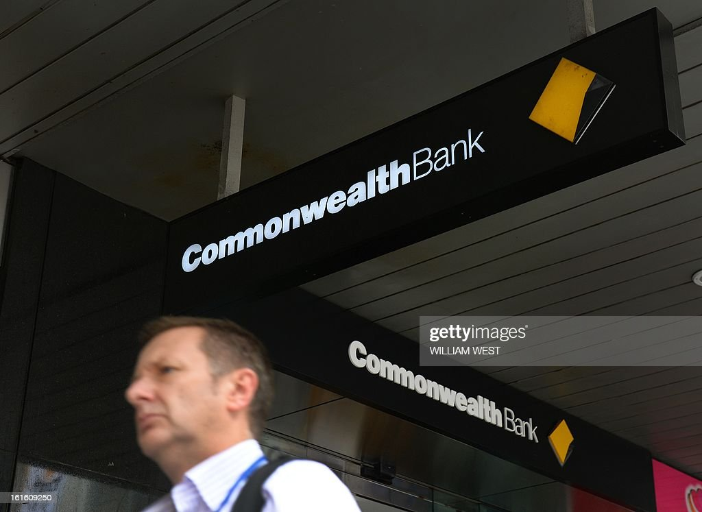 A man walks past an inner-city branch of Australia's largest lender Commonwealth Bank which posted a one percent rise in first-half net profit to Aus$3.66 billion (US$3.77 billion) despite subdued market conditions, in Sydney on February 13, 2013. The bank's result for the six months to December 31 was up from $3.62 billion in the same period the previous year. Its cash profit, a measure often preferred by financial institutions, rose six percent to Aus$3,78 billion, slightly above analyst expectaions. AFP PHOTO/William WEST