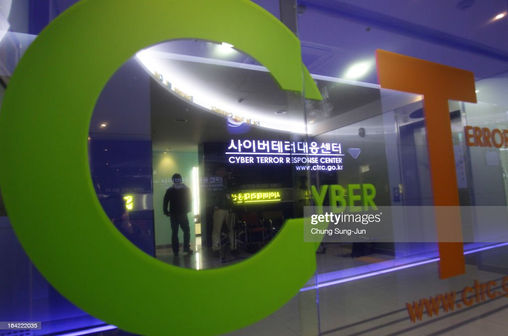 A man walks past at Cyber Terror Response Center at National Police Agency on March 21, 2013 in Seoul, South Korea. A cyber attack on the computer networks that run three South Korean banks, two broadcasters and an internet service provider in South Korea yesterday has been traced to an IP address in China, despite many experts suspecting the attacks to originate in North Korea. Officials noted that while the attack was traced to an IP address it China may have originated elsewhere and been routed through the country to disguise the attackers.
