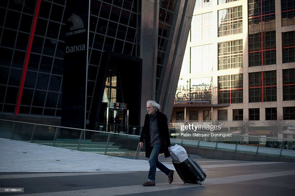 A man walks past Bankia building at Plaza de Castilla on December 3, 2012 in Madrid, Spain. Spain has formally requested 39.5 billion euros of European funds to bailout a number of its struggling banks.