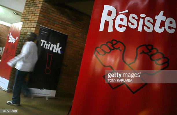 A man walks past banners against the EU backed Economic Partnership Agreements EPA's September 2007 at a concert by Kenyan artists aimed at creating...
