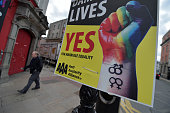 A man walks past billboard posters promoting the Yes campaign in favour of samesex marriage on May 22 2015 in Dublin Ireland Voters in the Republic...