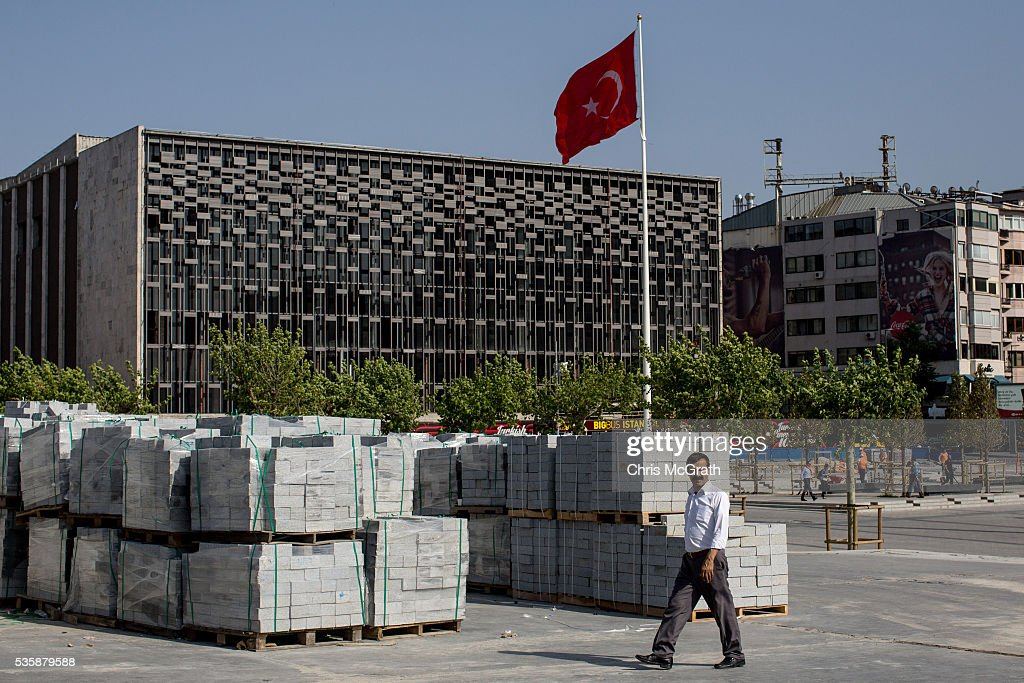 A man walks past bricks being used in the redevelopment of Gezi Park and Taksim Square on the eve of the 3rd anniversary of the Gezi Park protests on May 30, 2016 in Istanbul, Turkey. The protests began on May 28, 2013 to contest the planned urban development of Gezi Park however larger protests started after police evicted protesters from the park sparking weeks of civil unrest.