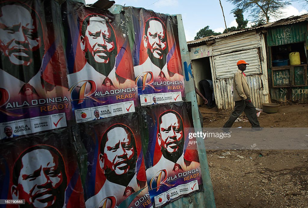 A man walks past campaign posters advertising Presidential candidate and Prime Minister Raila Odinga in Nairobi's Kibera slum on February 27, 2013. Kenya is gearing up for presidential, gubernatorial, senatorial elections on March 4, the first since bloody post-poll violence five years ago in which more than 1,100 people died after contested results.