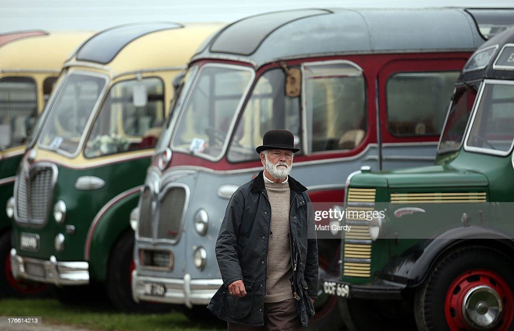 A man walks past classic buses and coaches being shown in the showground at the Cornish Steam and Country Fair at the Stithians Showground on August 16, 2013 near Penryn, England. The annual show, now in 58th year, is one of Cornwall's largest outdoor events and is one of the UK's most popular and respected steam rallies.