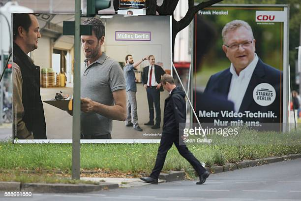 A man walks past election campaign billboards for the German Social Democrats that shows current Berlin mayor Michael Mueller and the German...