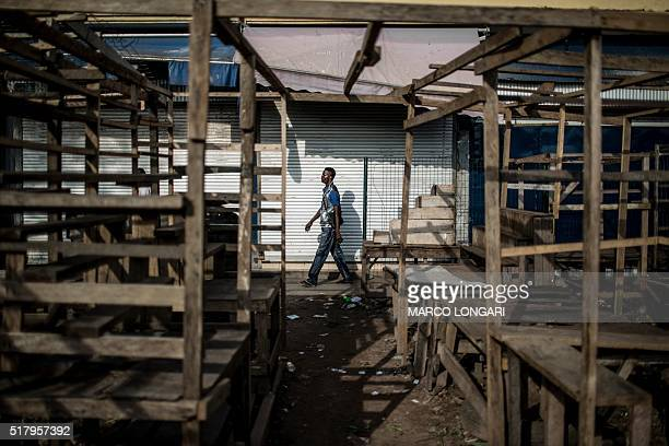 A man walks past empty stalls and closed shops during a 'dead city' strike called by five defeated opposition candidates to protest the reelection of...