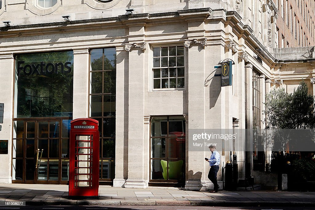 A man walks past Foxtons Estate Agents in Mayfair on September 20, 2013 in London, England. Foxtons has been valued at £649 million ahead of its full stock market listing. Shares in the company were priced at GBP 2.30 each.