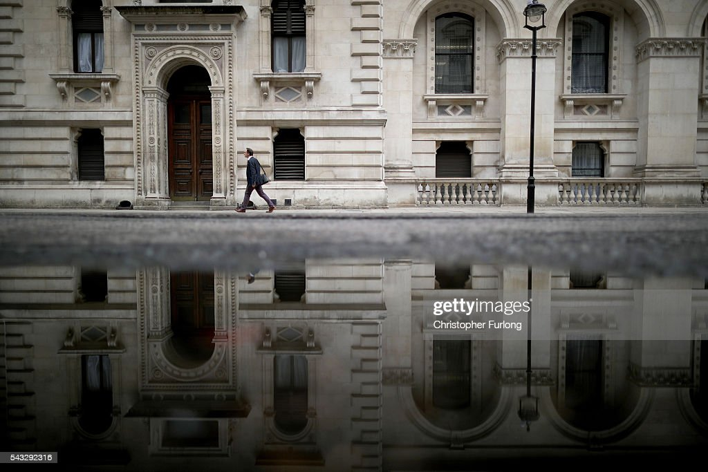 PA man walks past government buildings in Whitehall as David Cameron holds his first cabinet meeting since Brexit on June 27, 2016 in London, England. British Prime Minister David Cameron held an emergency Cabinet meeting this morning, after Britain voted to leave the European Union. Chancellor George Osborne spoke at a press conference ahead of the start of financial trading and outlining how the Government will 'protect the national interest' after the UK voted to leave the EU.