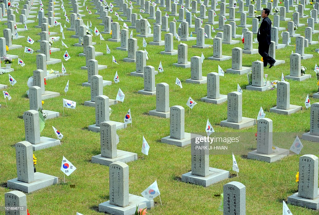A man walks past graves during a visit to a national cemetary on Memorial Day in Seoul on June 6, 2010. The US and its Asian allies demanded North Korea pay a price for the alleged sinking of a South Korean warship, even as Washington acknowledged diplomacy may have no effect on the reclusive regime.