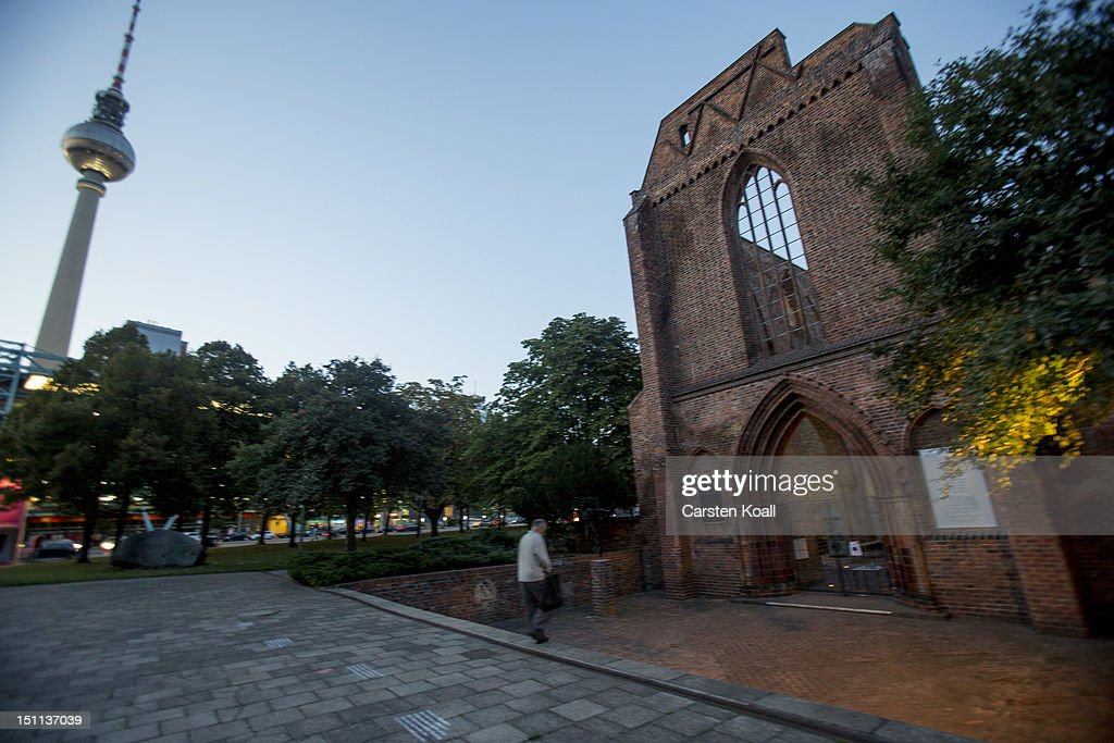 A man walks past he ruins of the abbey, once the most important Gothic building in the city with Berlins broadcast tower visible in the background on September 1, 2012 in Berlin, Germany. The church is part of ongoing exhibitions and events ahead of Berlin's 775th anniversary, which the city will mark with a celebration scheduled for the end of October.