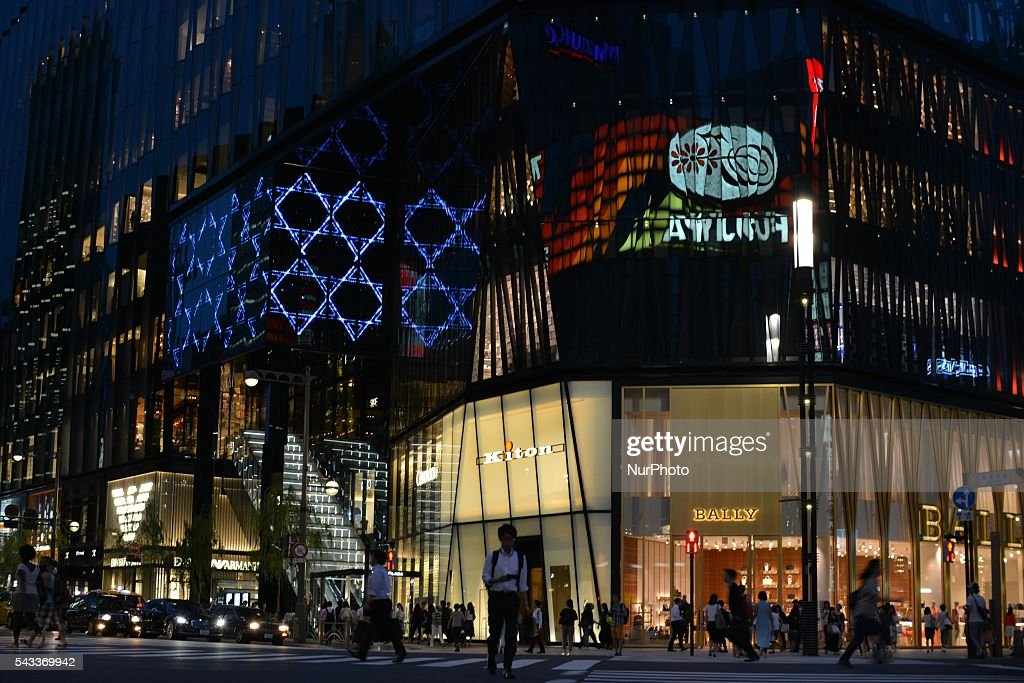 A man walks past in front of the Tokyu Plaza Ginza in Tokyo, Japan June 27, 2016. It is one of the largest scale retail structures in Ginza with a total of 125 stores.