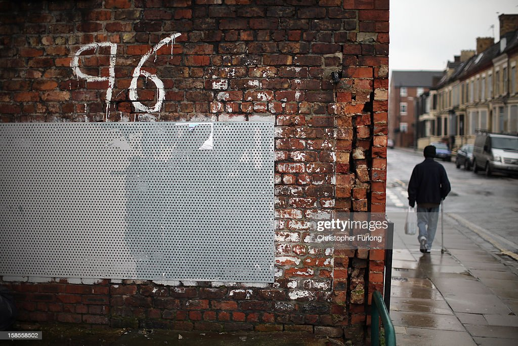 A man walks past Justice for the 96 graffiti outside Liverpool Football Club as the High Court quashes the 'Accidental Death' verdict on December 19, 2012 in Liverpool, England. An application presented by the Attorney General, Dominic Grieve to Lord Chief Justice Lord Judge has resulted in the quashing of the original accidental death verdict and an order for fresh inquests. The Hillsborough disaster occurred during the FA Cup semi-final tie between Liverpool and Nottingham Forest football clubs in April 1989 at the Hillsborough Stadium in Sheffield, which resulted in the deaths of 96 football fans.
