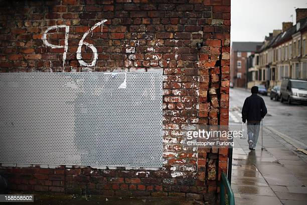A man walks past Justice for the 96 graffiti outside Liverpool Football Club as the High Court quashes the 'Accidental Death' verdict on December 19...