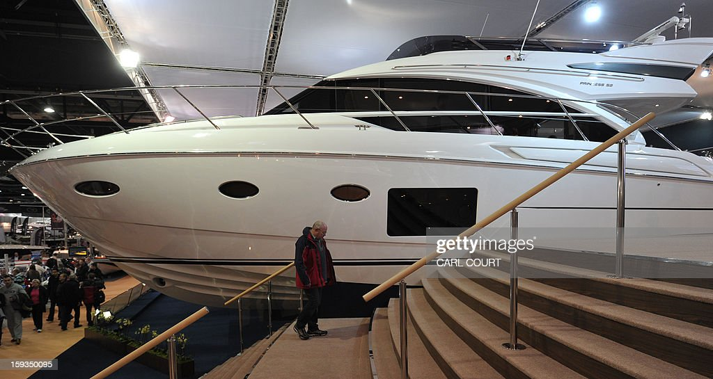A man walks past luxury motor boats on display at the 2013 London Boat Show in east London on January 12, 2013. The nine-day show features everything from speedboats to dinghies, boat paint to hot tubs with exhibits from many major marine and watersports related brands.