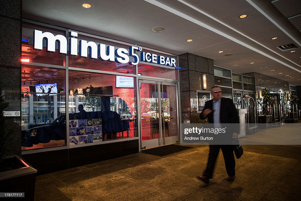A man walks past Minus5 Ice Bar during a media preview on July 9, 2013 in New York City. The bar, which opened yesterday, is built from 90 tons of ice, kept at 23 degrees Fahrenheit, or minus 5 degrees Celsius, and can hold 55 people.