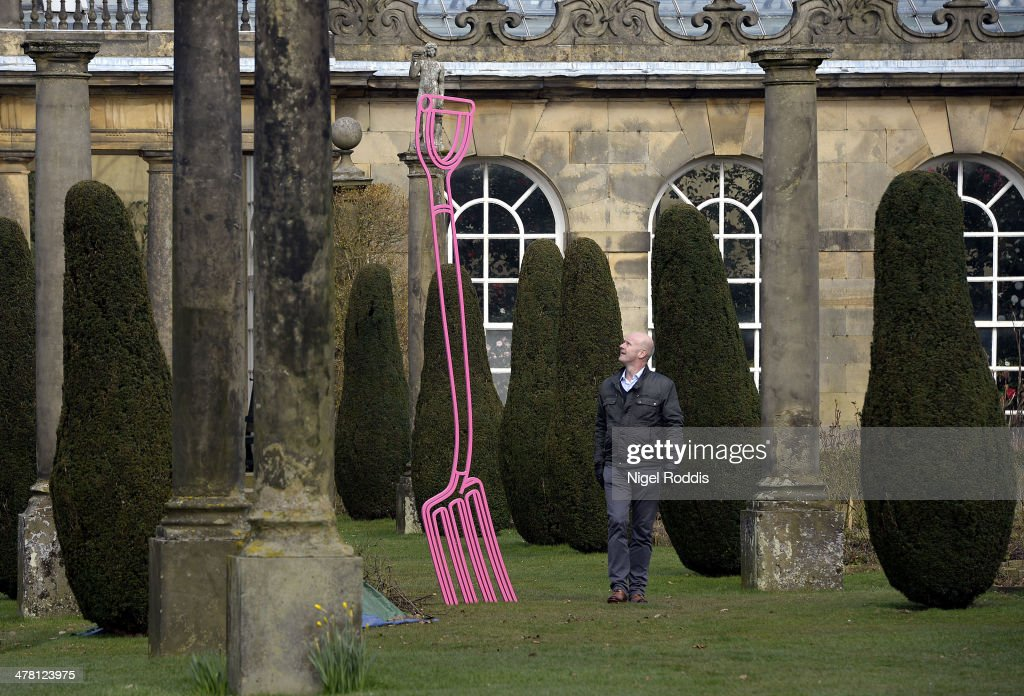 A man walks past Pinkfolk, by artist Michael Craig-Martin, which is part of a new exhibition of his work at Chatsworth House on March 12, 2014 in Chatsworth, England. Chatsworth House reopens after a winter break on Sunday 16th March