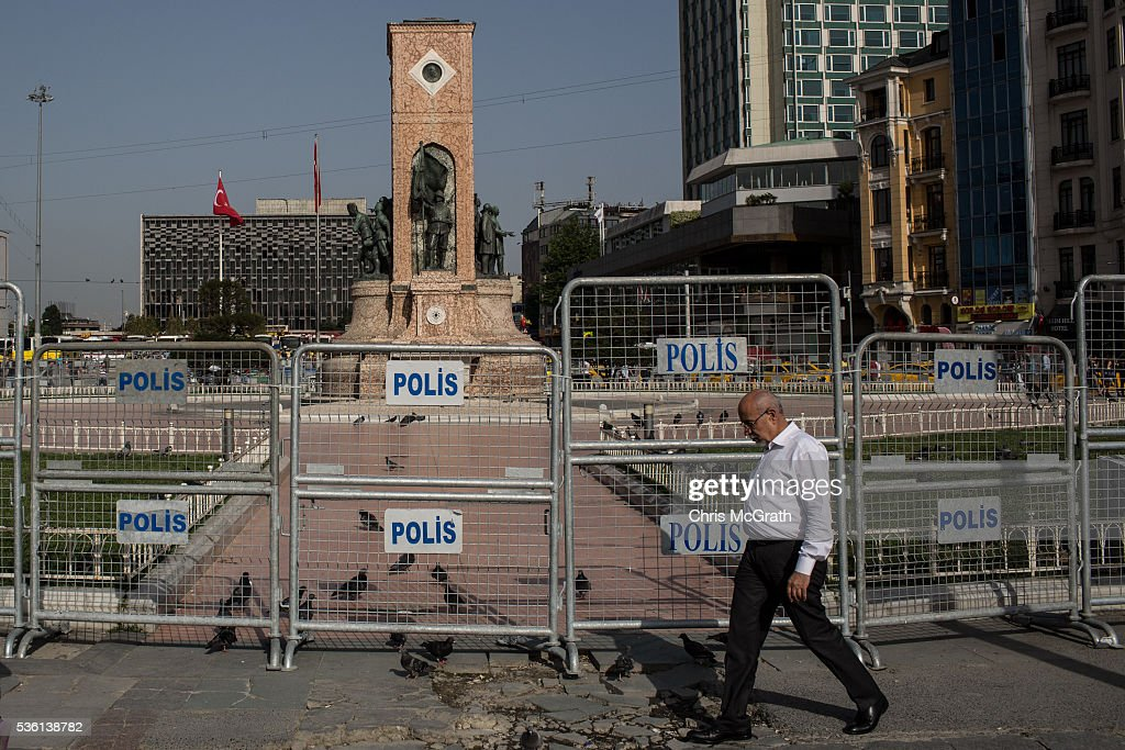 A man walks past police barricades surrounding Taksim Square and Gezi Park on the third anniversary of the Gezi Park protests on May 31, 2016 in Istanbul, Turkey. The protests began on May 28, 2013 to contest the planned urban development of Gezi Park, however larger protests started after police evicted protesters from the park sparking weeks of civil unrest.