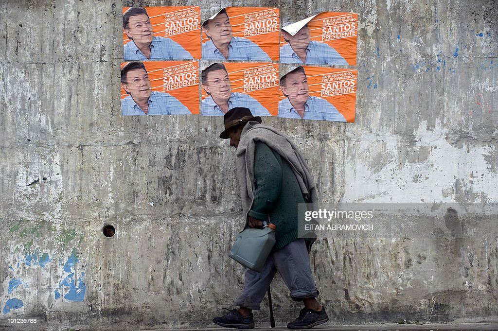A man walks past propaganda posters of Colombian presidential candidate for the ruling National Unity Party, Juan Manuel Santos, in Chipaque, Cundinamarca department, Colombia on May 28, 2010. Colombia will hold presidential elections next May 30, and according to polls, a run-off election between Santos and the presidential candidate for the Green Party, Antanas Mockus, will take place on June 20. AFP PHOTO/Eitan Abramovich