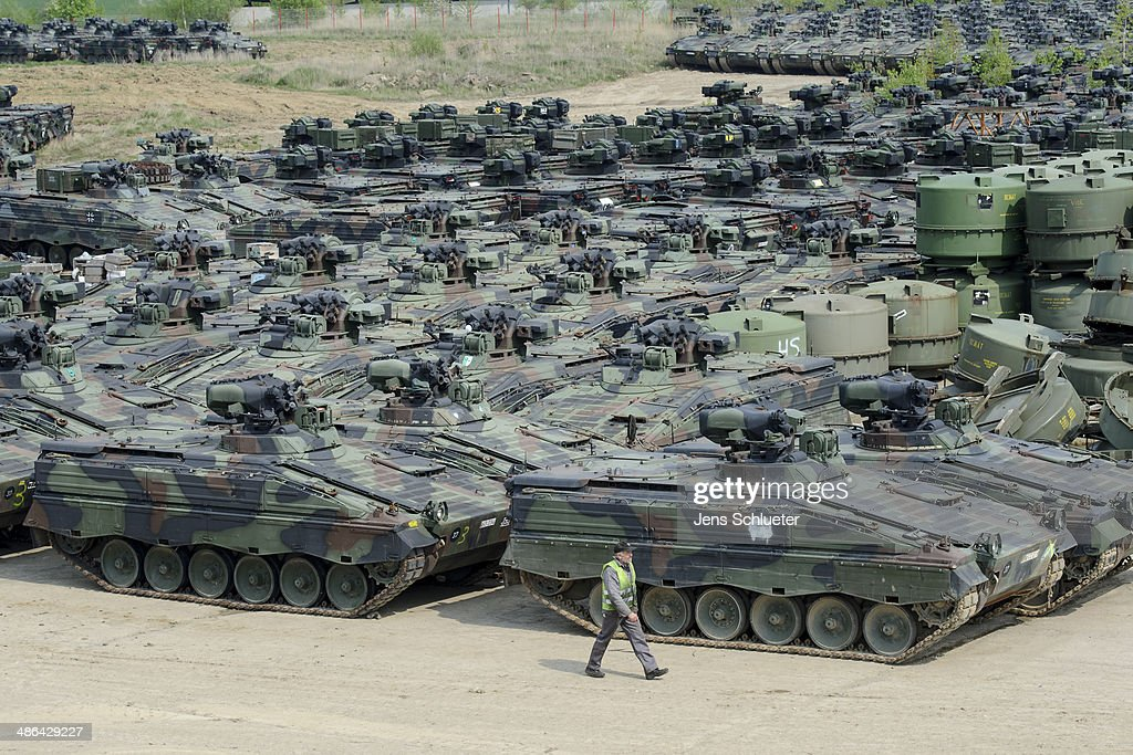 A man walks past several Marder light tanks that once belonged to the Bundeswehr at the Battle Tank Dismantling GmbH Koch on April 23, 2014 in Edeleben, Germany. Since the early 1990s the company has dismantled over 15,000 tanks and other armoured vehicles, from German, Austrian, French and other European arsenals, as many nations reduce their military forces in accordance with the Conventional Armed Forces in Europe Treaty.