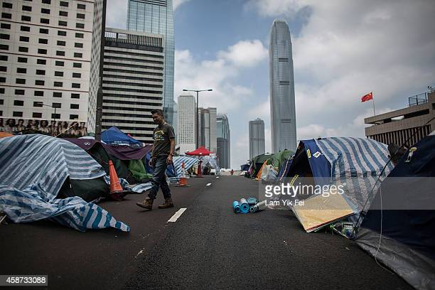 A man walks past tents at Admiralty occupy site on November 10 2014 in Hong Kong The occupy movement which began in Hong Kong on September 28 2014...