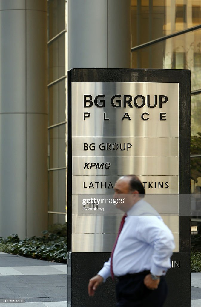 A man walks past the BG Group Place sign displayed outside the companies building in Houston, Texas, U.S., on Monday, March 18, 2013. Office sales in Houston, the fourth-largest U.S. city, jumped 32 percent last year to $3.89 billion, the highest total in five years and outpacing the 21 percent gain for the entire U.S., according to the research firm Real Capital Analytics. Photographer: Aaron M. Sprecher/Bloomberg via Getty Images