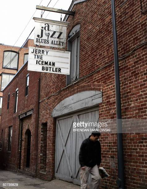 A man walks past the Blues Alley jazz club in Washington DC's Georgetown neighborhood 11 February 2005 Founded in 1965 Blues Alley bills itself as...