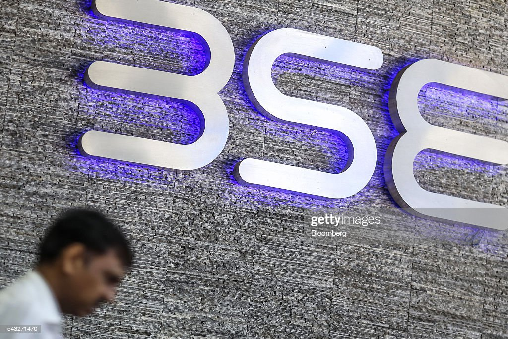 A man walks past the Bombay Stock Exchange (BSE) logo displayed outside the building's lobby in Mumbai, India, on Monday, June 27, 2016. Most Indian stocks advanced, led by companies tied to the economy, as some investors judged Friday's Brexit-induced selloff is overdone. Tata Consultancy Service Ltd. (TCS) and Infosys, India's top software exporters that earn about a quarter of their revenue from Europe, were the biggest losers on the benchmark S&P BSE Sensex. Photographer: Dhiraj Singh/Bloomberg via Getty Images