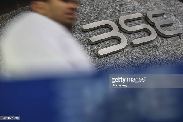 A man walks past the Bombay Stock Exchange logo in Mumbai India on Friday Jan 27 2017 While economists urge more investment in roads ports and...