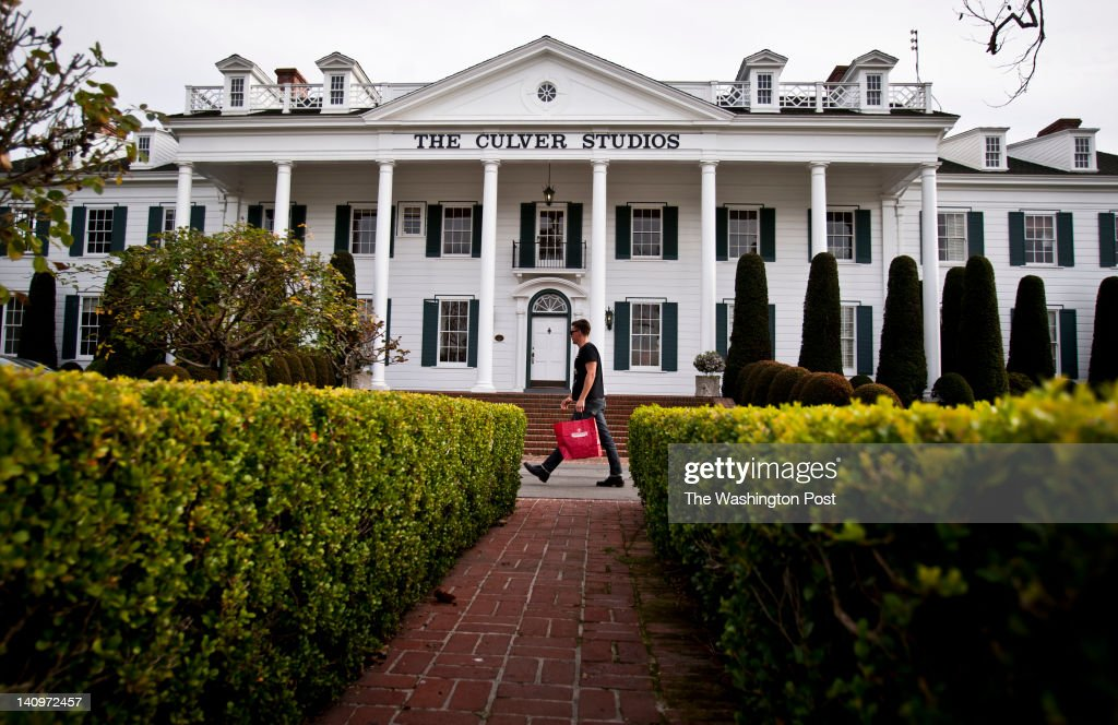 A man walks past the colonial mansion, which is now the administration building, at The Culver Studios on January 30, 2012, in Culver City, California. A shot of the mansion was the opening logo for all of David O. Selznick's movies, such as 'Gone with the Wind'.