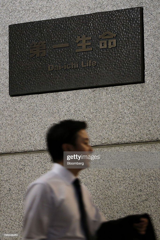 A man walks past the Dai-Ichi Life Insurance Co. headquarters in Tokyo, Japan, on Tuesday, Nov. 13, 2012. Dai-Ichi Life is scheduled to announce first-half earnings results on Nov. 14. Photographer: Kiyoshi Ota/Bloomberg via Getty Images