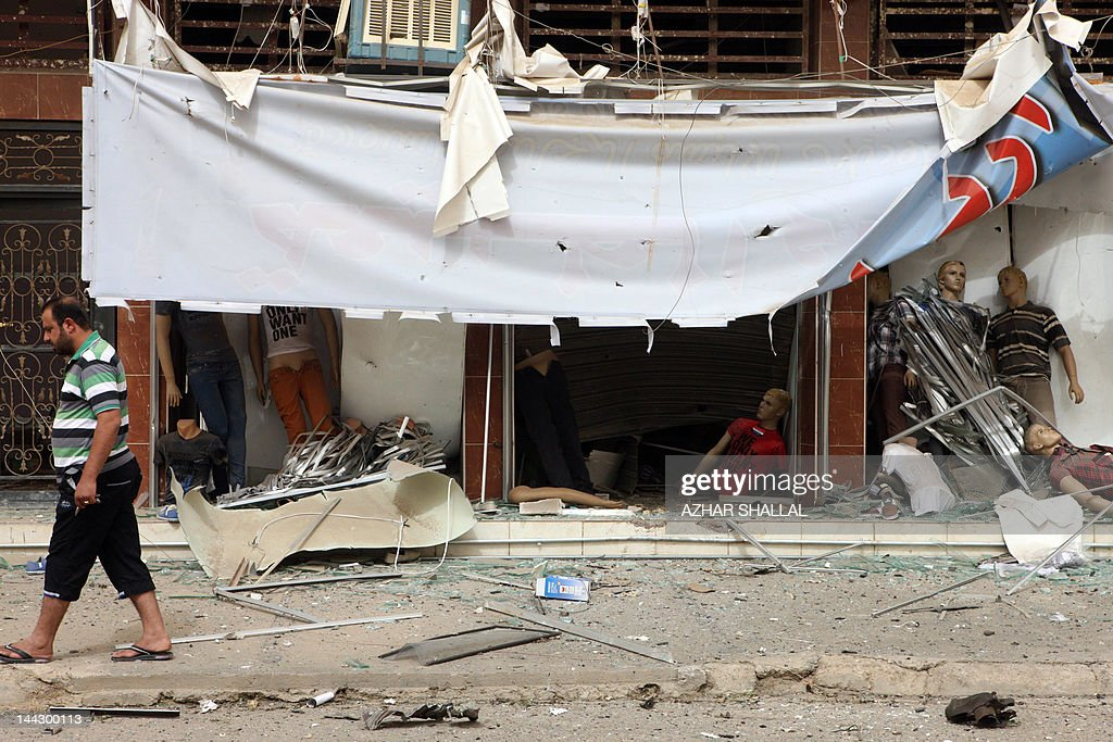 A man walks past the debris of a shop following a car bomb believed to be targeting a police patrol in the center of the city of Ramadi, Anbar provincial capital, in western Iraq, 100kms from the capital Baghdad, on May 13, 2012, in which one person died and seven others were wounded according to medical sources.