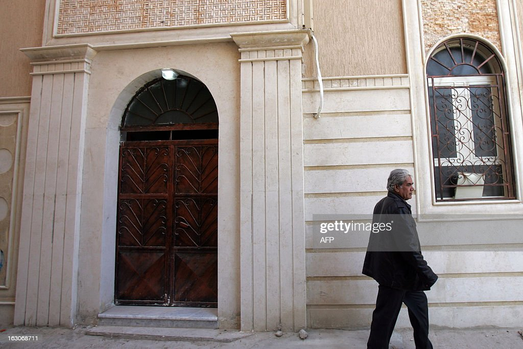 A man walks past the Egyptian Coptic church that was attacked the previous night on March 4, 2013 in the eastern city of Benghazi. Gunmen attacked the Egyptian Coptic church in Libya's eastern city, assaulting two priests, the foreign ministry said on March 3, days after dozens of Egyptian Christians suspected of proselytising were arrested.