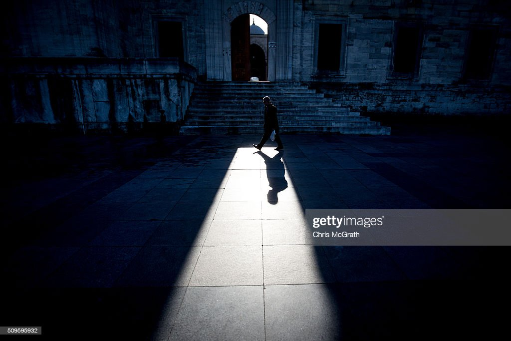 A man walks past the entrance of the Eminonu Mosque on February 11, 2016 in Istanbul, Turkey. Istanbul is famous for its skyline dotted with historic mosques, it is home to more than 3000 mosques, the most of any city in Turkey and includes the famous Blue Mosque and Suleymaniye Mosque.