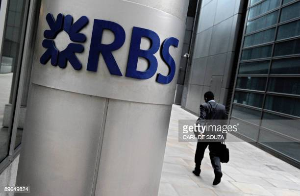 A man walks past the entrance to the London headquarters of the Royal Bank of Scotland on August 7 2009 Staterescued Royal Bank of Scotland on Friday...