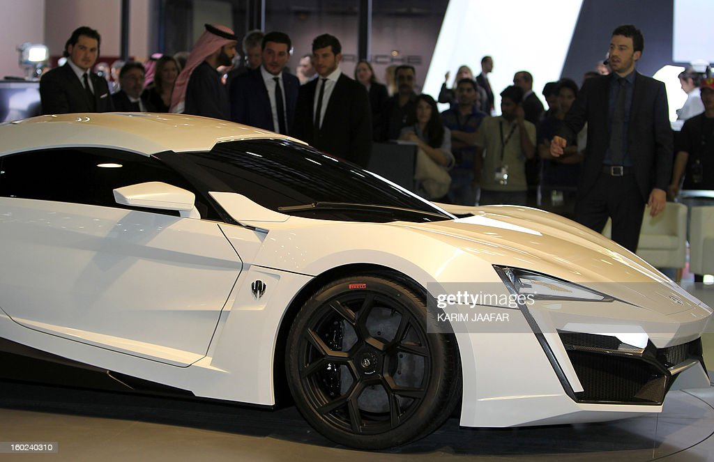 A man walks past the first Arabian supercar, LykanHypersport, during the third International Qatar Auto Show on January 28, 2013 in Doha. Created by Beirut-based W Motors the LykanHypersport is labeled as the most exclusive, luxurious and technologically advanced Hypercar in the world that boasts never seen before cutting-edge technologies inside and out. AFP PHOTO / AL-WATAN DOHA / KARIM JAAFAR == QATAR OUT ==
