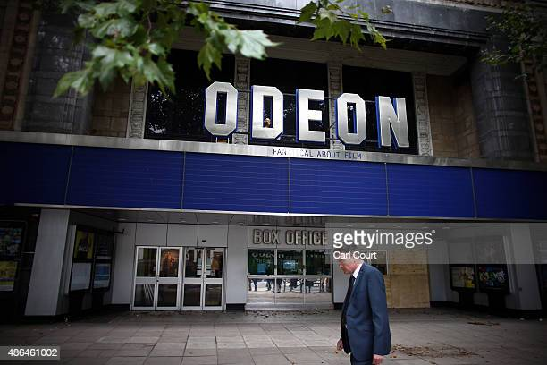 A man walks past the former Odeon cinema on September 4 2015 in Kensington London England Despite protests from local residents developers won...
