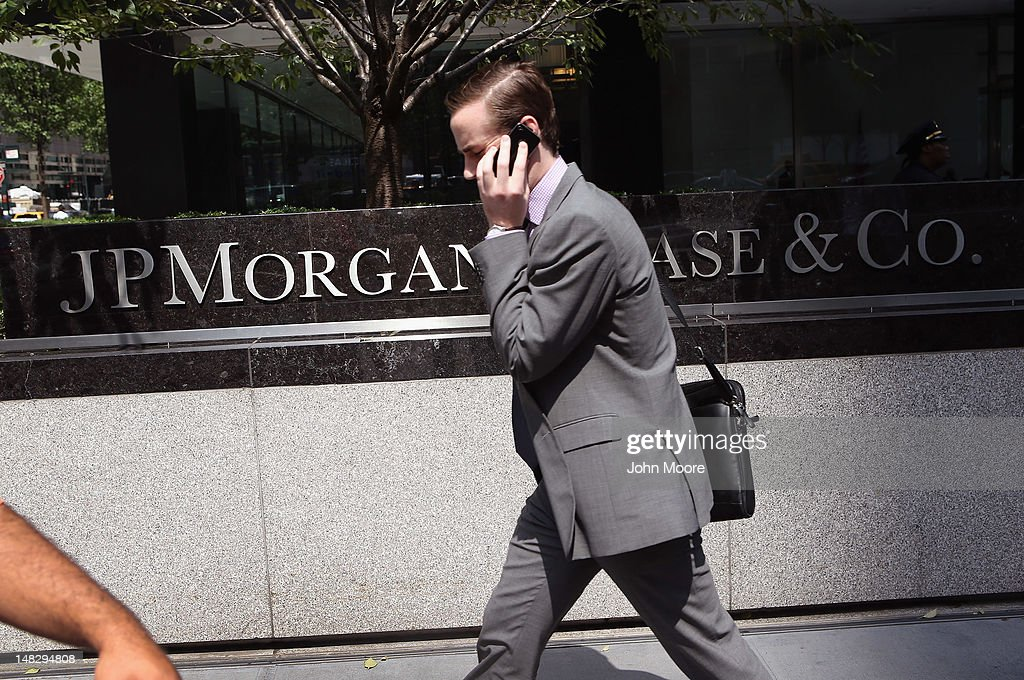 A man walks past the headquarters of JPMorgan Chase on Park Avenue in midtown Manhattan on July 13, 2012 in New York City. The bank, which reported its second-quarter results on Friday, disclosed that the losses on a credit bet could mount to more than $7 billion, as the nation's largest bank indicated that traders may have intentionally tried to conceal the extent of the loss. JPMorgan also said Friday that it would be forced to restate its first-quarter results.