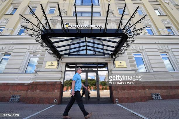 A man walks past the headquarters of Russia's statecontrolled oil giant Rosneft in Moscow on June 28 2017 A wave of cyberattacks hit Russia and...