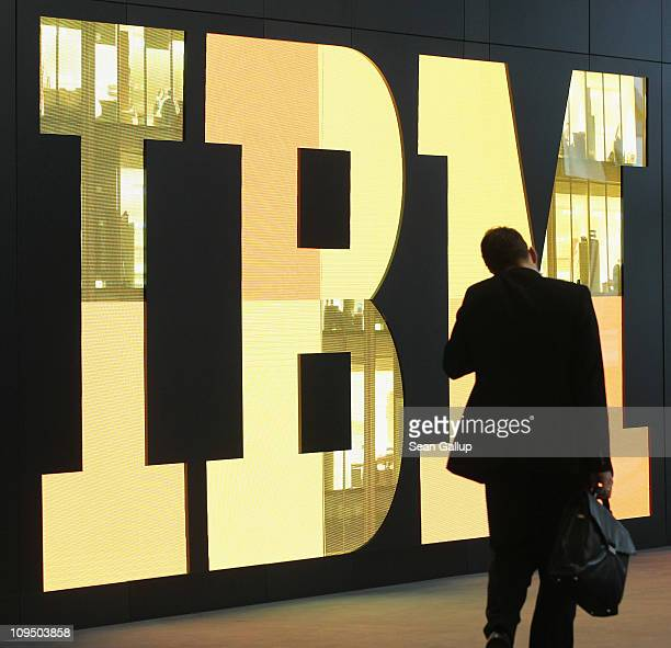 A man walks past the IBM logo at the CeBIT technology trade fair the day before the fair's official opening on February 28 2011 in Hanover Germany...