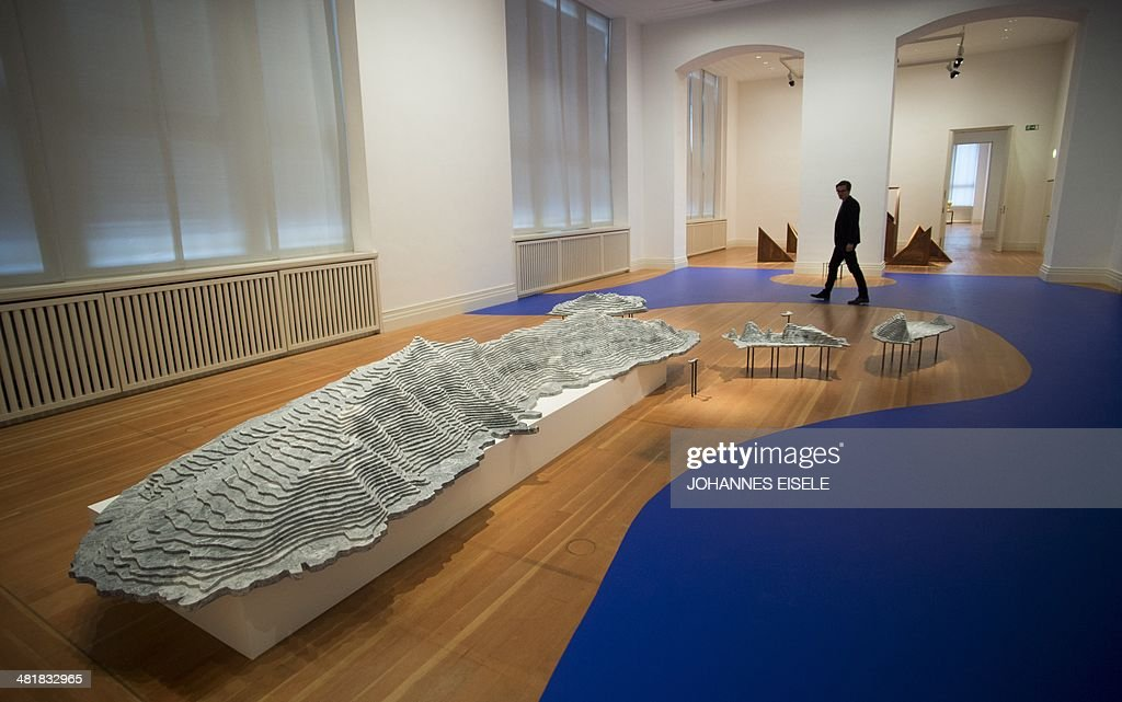 A man walks past the installation 'Diaoyu Islands' made of marble by Chinese artist Ai Weiwei on display as part of the exhibition 'Evidence' at the...