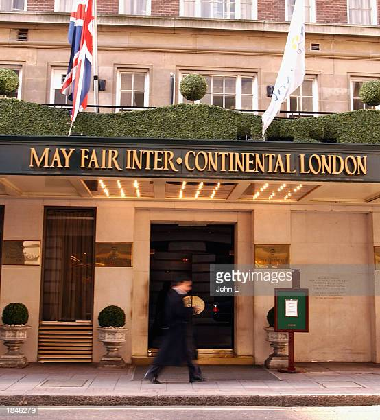A man walks past the InterContinental Hotel in Mayfair March 13 2003 in London Six Continents the world's biggest international hotelier won its...