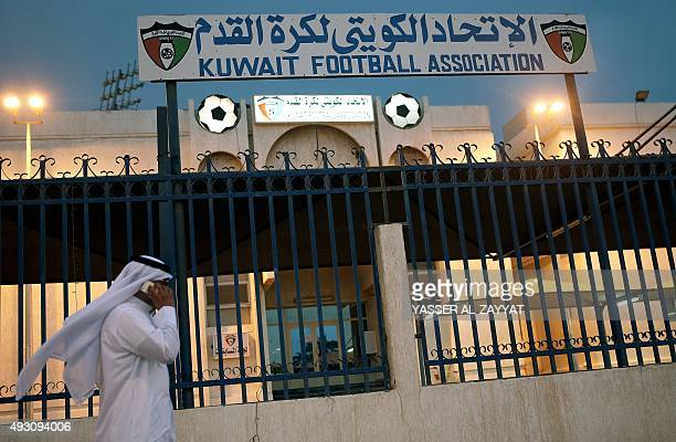 A man walks past the Kuwaiti Football Association 's headquarters on October 17 in Kuwait City The KFA was suspended by FIFA on October 16 for...
