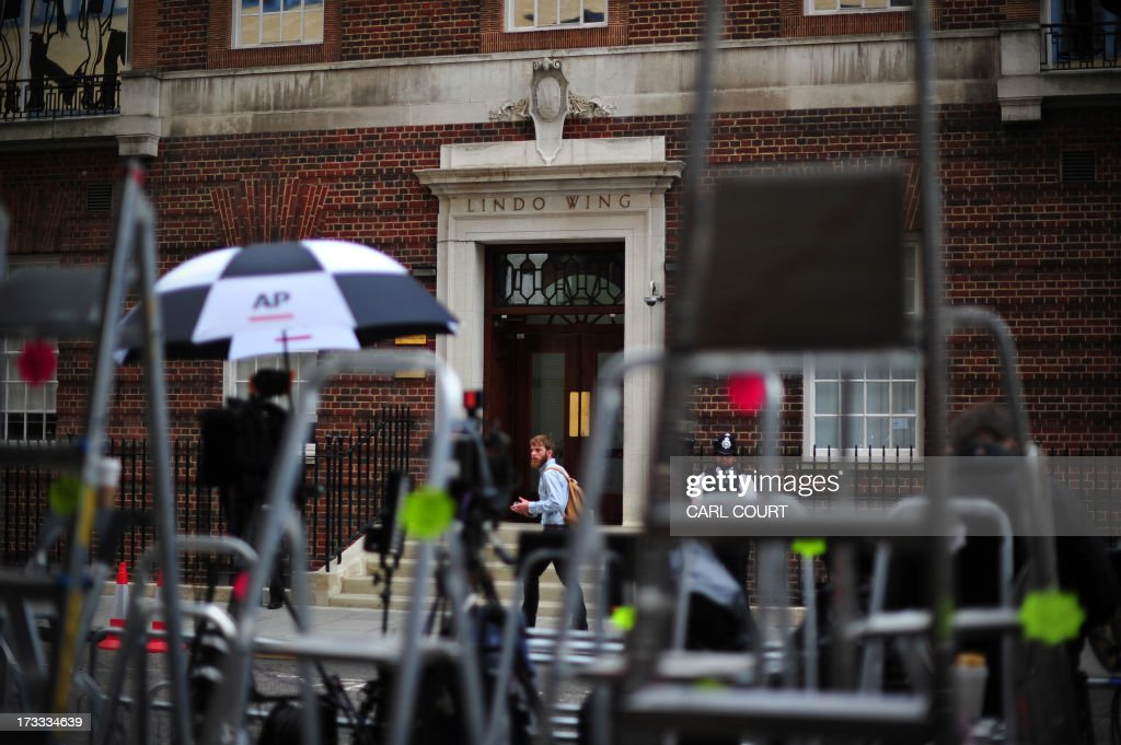 A man walks past the Lindo Wing of Saint Mary's Hospital in London, on July 12, 2013, where Prince William and his wife Catherine's baby will be born. Britain's royal family and the world's media are on tenterhooks awaiting the birth of Prince William and wife Catherine's first child, a baby who will one day be king or queen of Britain and a diverse group of commonwealth countries.